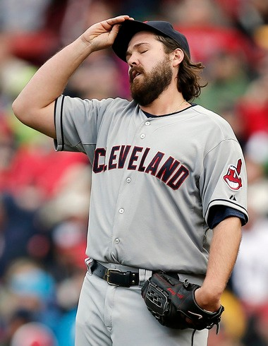 Cleveland Indians relief pitcher Chris Perez reacts after giving up a hit to Boston Red Sox's Stephen Drew during the ninth inning of Boston's 6-5 win at Fenway Park in Boston, Sunday,.