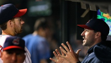 Cleveland Indians pitching coach Mickey Callaway talks with pitcher Zach McAllister in the dugout during the Tribe's sweep of Houston over the weekend.
