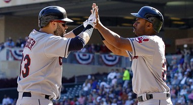 The Indians need better overall seasons in 2014 from Nick Swisher (left) and Michael Bourn.