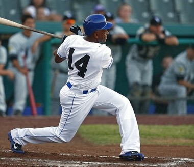 Former Indians' shortstop Julio Franco, 55, hits into a double play Tuesday after joining the Forth Worth Cats, an independent team. Franco wants to get back into baseball as a coach or manager.
