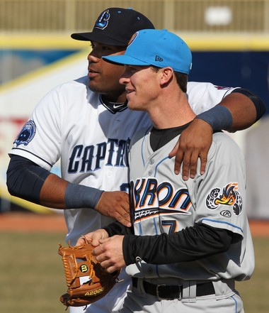 Lake County Captains first baseman Nellie Rodriguez (left) greets Akron RubberDucks infielder Joe Wendle before their exhibition game  April 1. Rodriguez's 16 home runs ranks second among Indians minor-leaguers.