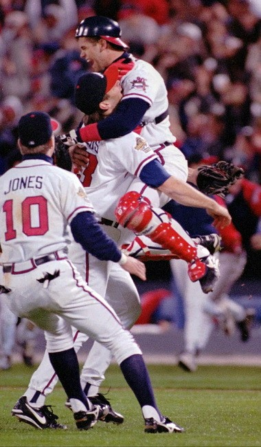 The Atlanta Braves' Mark Wohlers (43), Javier Lopez (8) and Chipper Jones (10) celebrate after the Braves won the 1995 World Series against the Cleveland Indians in Atlanta in this Oct. 28, 1995 photo. Though the Braves won 10 straight division titles, 1995 was the only time they won the World Series. (AP Photo/Mark Duncan)