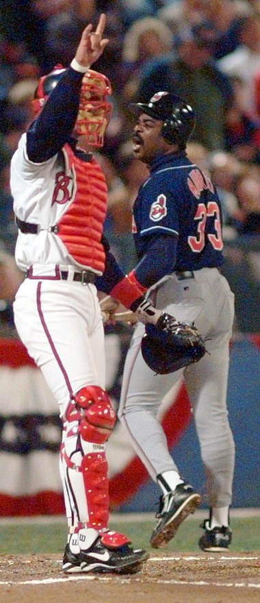 Atlanta Braves catcher Javy Lopez signals the second out of the second inning as the Cleveland Indians' Eddie Murray has words with home plate umpire Joe Brinkman, (not shown) over his strikeout in Game Six of the World Series Saturday, Oct. 28, 1995, in Atlanta. (AP Photo/Eric Draper)