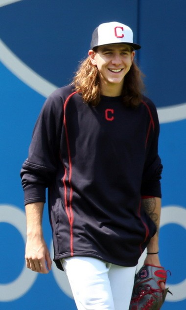 Cleveland Indians rookie pitcher Mike Clevinger, who will make his first major league start in Cincinnati on Wednesday, in the outfield during batting practice before the game against the Cincinnati Reds at Progressive Field in Cleveland, Ohio on May 17, 2016.