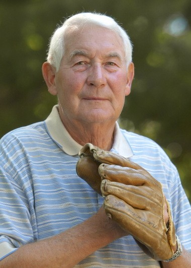 Bob Addis holds the glove he used as an outfielder for the Boston Braves and Chicago Cubs from 1950-53, at his home in Mentor, Ohio.