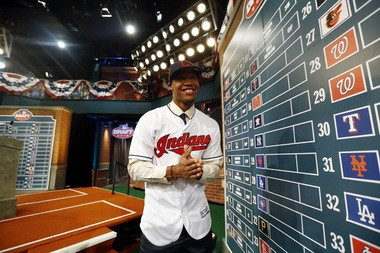 Will Benson, an outfielder from The Westminster Schools in Atlanta, smiles after being drafted No. 14 by the Cleveland Indians in the first round of the Major League Baseball draft, Thursday, June 9, 2016, in Secaucus, N.J.