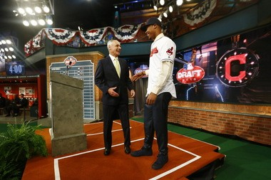 MLB Commissioner Rob Manfred, left, talks to Will Benson, an outfielder from The Westminster Schools in Atlanta, after Benson was drafted No. 14 by the Cleveland Indians in the first round of the Major League Baseball draft, Thursday, June 9, 2016, in Secaucus, N.J.