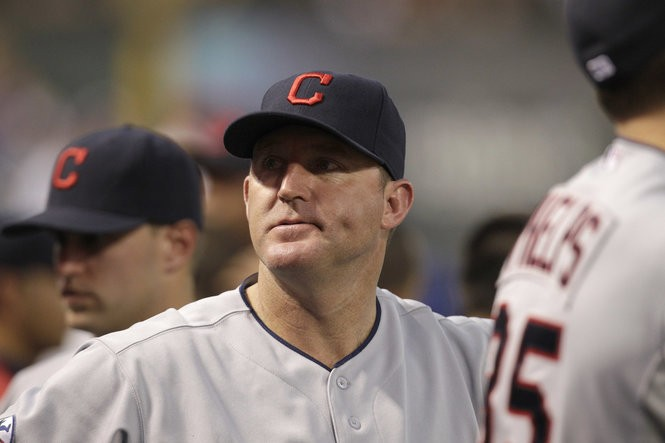 Jim Thome wearing an Indians road blue 'Block-C' cap during a game against Texas in 2011.