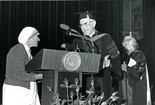 Mother Teresa of Calcutta, left, receives an honorary doctorate of humane service degree at JCU in April 1978. The Rev. Henry F. Birkenhauer presented the degree. At right is Sally Griswold, a 1976 JCU grad and honorary trustee.