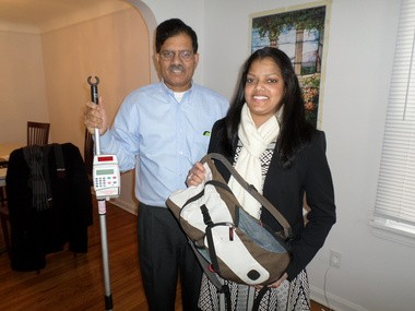 Swapna Kakani, 25, holding the backpack and intravenous pole that had been so much a part of the first 24 years of her life. Kakani is living in University Heights with her father, Babu Kakani, left, while she is treated following her Cleveland Clinic surgery for an intestine transplant.