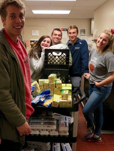 Members of John Carroll University's Arrupe Scholars Program took a moment for a photo while at the Fatima Family Center in Cleveland's Hough neighborhood, where they recently delivered food to those in need. From left are Paul Gehrig, Caitlin Matthews, Richard Jenkins, Matthew Rombalski and Kaleigh Wagner.