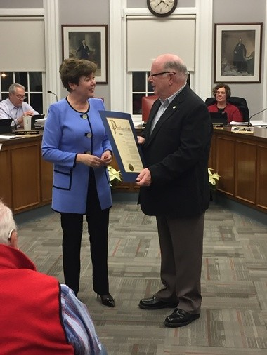 Mayor Susan Infeld presents Jerry Jacobson a proclamation declaring him 'University Heights Citizen of the Year.'