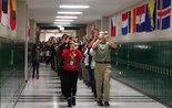 The Westlake High School Marching Band parades through the school.