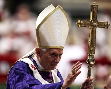 Pope Benedict XVI greets the faithful at the end of the Ash Wednesday Mass in St. Peter's Basilica at the Vatican on Wednesday, only days after he announced he would resign.