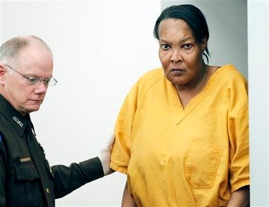 Morris Garner, who also goes by the name Tracey Lynn Garner, is escorted into a Hinds County courtroom by bailiff Tony Queen in Jackson, Miss., Tuesday, Sept. 11, 2012, for a bond hearing. Garner, who dresses and lives as a woman, has been charged with depraved-heart murder after performing an illegal buttocks implant that killed a Georgia woman, authorities said. (AP Photo/Rogelio V. Solis)