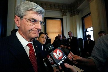 In this March 14, 2013 photograph, Gov. Phil Bryant informs reporters at the Capitol in Jackson, that he'll sign a new law to prevent cities or counties from banning extra-large soft drinks or requiring restaurants to list calorie counts on menus since he opposes local restrictions on food labeling or portion sizes because he sees them as interference into private business practices.