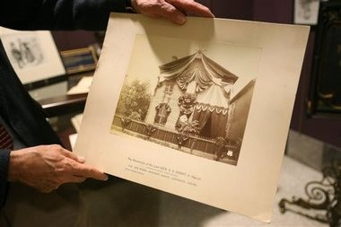 John Marszalek, Ph.D., shows a photo, which depicts the Detroit house Ulysses S. Grant and his wife had lived in, that was once owned by the Grants' daughter. (AP Photo/The Northeast Mississippi Daily Journal, Lauren Wood)
