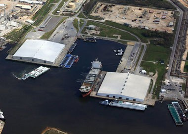 Shown in this aerial photo of the Port of Pascagoula's Bayou Casotte operations are Terminals E and F, which are served by the warehouse on the left, and Terminals G and H, served by the warehouse on the right. The warehouse on the left is expected to be torn down to make way for a new wood pellet export facility. (Photo courtesy of the Port of Pascagoula)