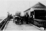 Oxen team brings sacks of charcoal to town on the original Fort Bayou Bridge in Ocean Srpings around 1901. The bridge tender is the white shirt is Leonard Fayard who got paid $30 a month.