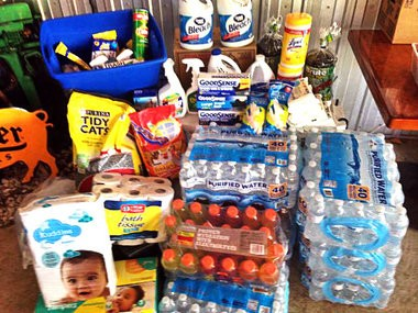 Numerous local businesses are helping with relief efforts for Louisiana flood victims, including Off The Hook Fish House in Ocean Springs, which has been stacking supplies on its patio dining area since announcing a supply collection drive Monday morning.