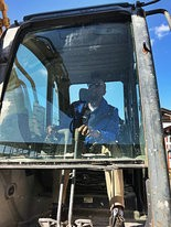 Moss Point Mayor Mario King is seen behind the controls of an excavator as the city starts the demolition project of the former building that was home to the Moss Point Police Department. (Mayor Mario King)