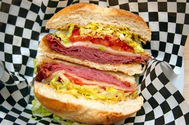 Fried Salami with spicy mustard, homemade Mozz., lettuce and tomato.