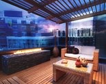 A rendering of a rooftop party deck and firepits at the Strata Luxury Flats. Click link to enlarge.