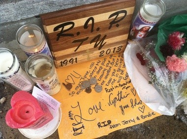 Candles burn in a makeshift memorial for Tyree Wimberly on the sidewalk outside Scoobies Gentleman's Club in Allentown.