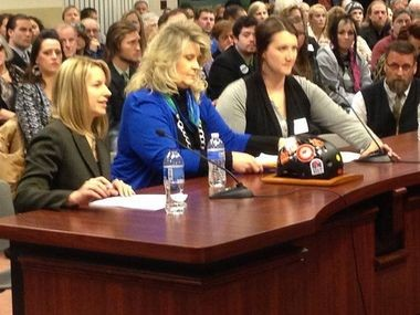 Deena Kenney, center, of Bethlehem, testifies in Harrisburg.