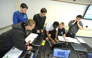Students work as a team on a timed marketing project Feb. 12 in a class taught by Wendi Achey, associate professor of business administration at Northampton Community College.