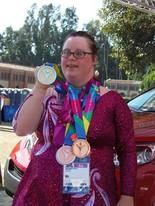 Amanda Reiss shows off her medals from the Special Olympics World Games in Los Angeles.