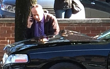 A man makes a call the afternoon of April 13, 2016, near the crunched front end of a limousine that was carrying Diana Ross to a show at the Sands. (Photo courtesy Brittany Garzillo)