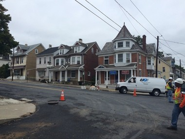 Caution tape runs in front of three homes the morning of Sept. 29, 2016, on North New Street between Garrison and North streets in Bethlehem and UGI workers were talking about a sinkhole that apparently ruptured gas and water lines nearby. (Sarah Cassi | For lehighvalleylive.com)