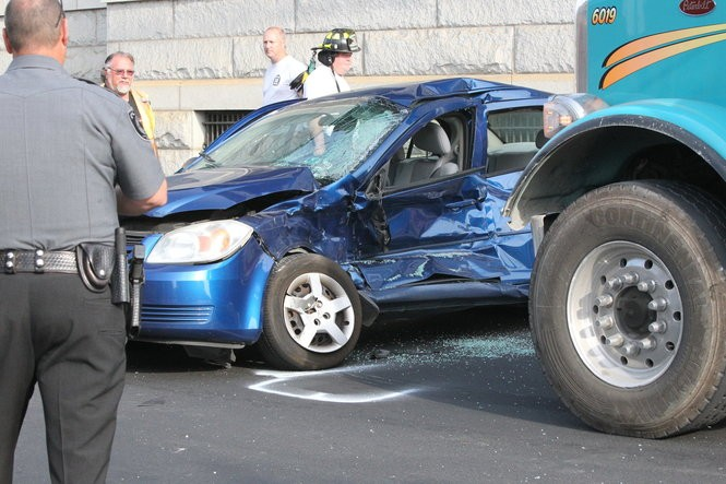 A car and a dump truck collided just after 7:30 a.m. July 22, 2016, at Pennsylvania and Robinson avenues in Pen Argyl. (Sue Beyer | For lehighvalleylive.com)