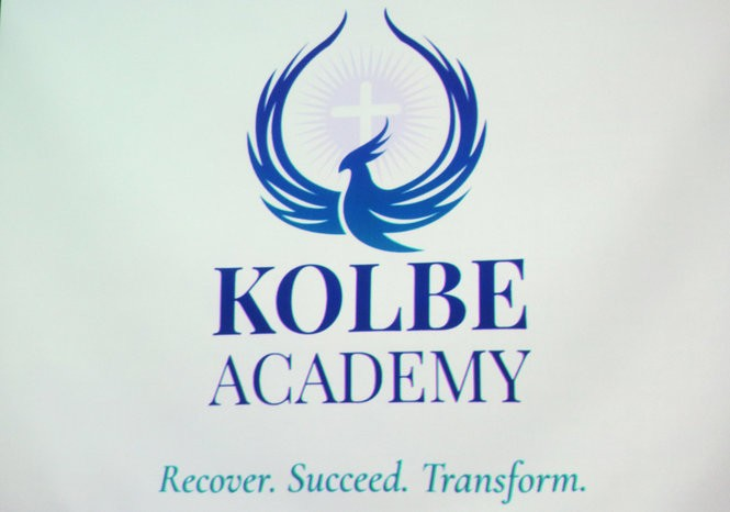 The logo for Kolbe Academy is projected during an announcement Sept. 7, 2018, about the new Catholic high school for students in recovery from drug or alcohol addiction in Hanover Township, Northampton County, outside Bethlehem. (Kurt Bresswein | For lehighvalleylive.com)