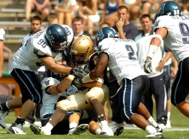 Villanova defenders gang tackle a Lehigh ball carrier during a 2007 independent football contest at Goodman Stadium.