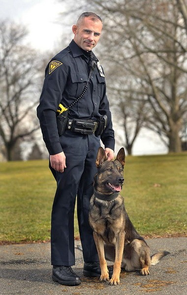 Wilson police officer Tom Migliore stands with Rex, the borough's new police dog.