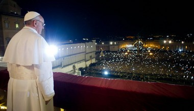In this photo provided by the Vatican newspaper L'Osservatore Romano, Pope Francis looks at the crowd from the central balcony of St. Peter's Basilica at the Vatican on Wednesday. Argentine Cardinal Jorge Mario Bergoglio, who chose the name of Pope Francis, is the 266th pontiff of the Roman Catholic Church.