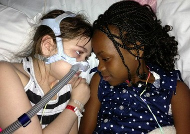 Sarah Murnaghan, left, lies in her hospital bed next to her sister Ella at Children's Hospital of Philadelphia.