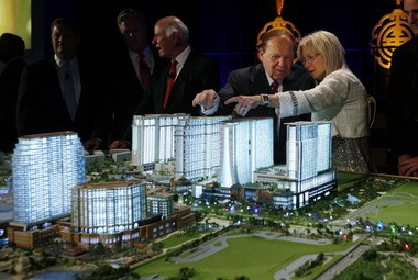 Las Vegas Sands Chairman and CEO Sheldon Adelson, second right, and his wife, Miriam Ochsorn, right, look at a model of the Sands Cotai Central resort during a news conference in Macau back in April 2012 to announce the launch of the $4.4-billion complex in Macau, China.