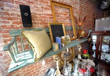This bench is repurposed into a shelf at Forgotten Treasure Chest in Easton.