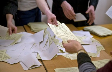 Referendum officials sort ballots at a polling station today in Simferopol, Ukraine.