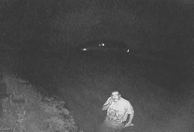 Authorities say this surveillance image shows Steven Gonzalez, 43, hauling several 10-foot galvanized steel beams, a sign and a light pole into a minivan June 10 in Moore Township.
