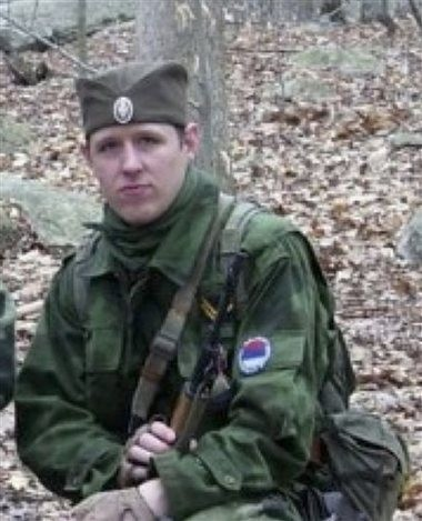 """In this undated photo provided by the Pennsylvania State Police, Eric Frein is shown. Frein, the suspect in last week's fatal ambush outside a rural Pennsylvania State Police barracks belonged to a """"military simulation unit"""" whose members play the role of soldiers from eastern Europe, police said Wednesday."""