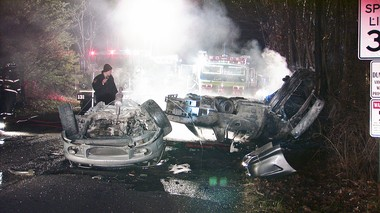 Wreckage smolders following a two-vehicle collision Dec. 19, 2014, on Dairy Road in Lower Towamensing Township, Carbon County, outside Palmerton, Pennsylvania. Four teenagers in one car were killed and two occupants of the second vehicle were hospitalized.