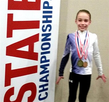 Cayla Owens wears the medals she earned from the 2017 USA Gymnastics N.J. Level 3 state championship. (Courtesy photo)