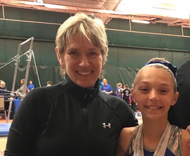 Brielle Ehasz is pictured with her coach, Yvette Sommer-Pechanec, of Twilight Gymnastics.