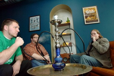 Ken Janowicz, right, Zach Van Nostrand and Brian Jones smoke a hookah at the site of their proposed Mellow Hookah Lounge in Easton.