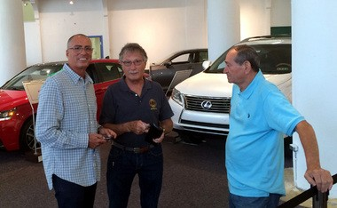 Lexus of Lehigh Valley owner Peter Cooper, left, reminisces this morning with former Continental Motors employees Ron Lerch, center, and Angelo Karaminas at the Lexus Experience on Easton's Center Square. Lerch and Karaminas worked many years ago for Cooper's father, Doug,
