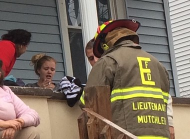 Amanda McCarty, with blonde hair, is comforted on a neighbor's front porch after a harrowing experience on Wednesday afternoon in a burning building in the 800 block of Ferry Street. (Tony Rhodin | For lehighvalleylive.com)